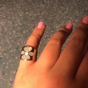 925 Silver ring with iridescent flower detail.